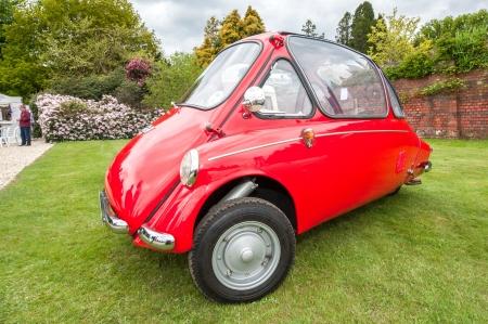bubble car: Winnersh, UK - May 18, 2013: A rare Heinkel designed Trojan 200 microcar (aka Bubble car - circa 1960) parked at Bearwood College in Winnersh, UK