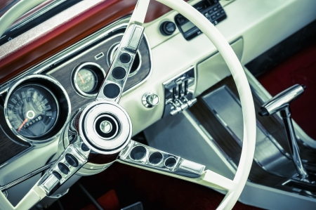 retro toned American muscle car dashboard and steering wheel photo