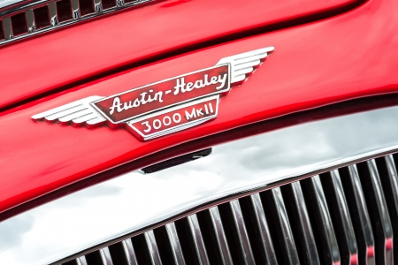 Winnersh, UK - May 18, 2013: Bonnet badge of a classic British made Austin-Healey car, part of a collection of vintage vehicles displayed for charity at Bearwood College in Winnersh, UK