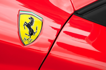 Winnersh, UK - May 18, 2013: Ferrari sports-car badge closeup; part of a collection of classic and modern vehicles displayed for charity at Bearwood College in Winnersh, UK