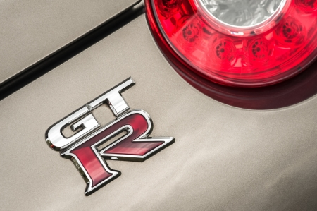 nissan: Winnersh, UK - May 18, 2013: Nissan GTR sports car badge closeup; part of a collection of classic and modern vehicles displayed for charity at Bearwood College in Winnersh, UK Editorial