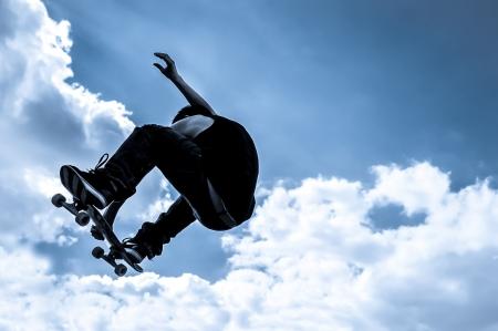 Tons bleu abstrait skateboarder au clair de lune Banque d'images - 20414099