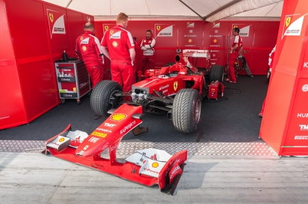 Goodwood, UK - July 13, 2013: Ferrari Formula 1 race car and mechanics at the Festival of Speed event in Goodwood, UK Editorial