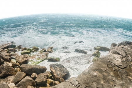curvature: curvature of the earth and crashing ocean waves seascape Stock Photo