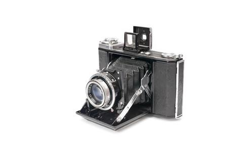 vintage bellows film camera circa 1940 isolated on white photo