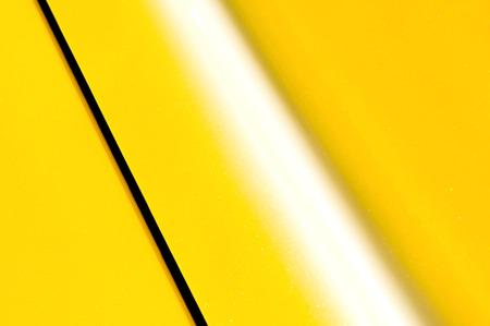 yellow car: bright yellow glittering vehicle panel background