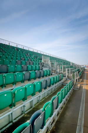 venue: empty grandstand seating at an outdoor sports venue Editorial