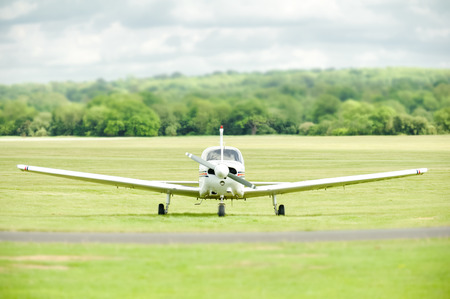 airstrip: light aircraft on a grass airstrip Stock Photo