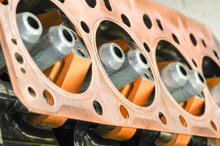 gasket: copper engine gasket and fuel injection nozzles Stock Photo