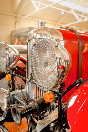 chromed: chromed headlamps on a vintage automobile
