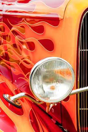 headlamp: colorful flaming paintwork and headlamp on a custom hotrod