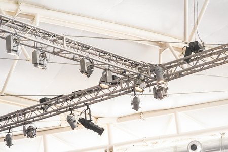 venue: lighting rig projecting bright lights inside a large marquee venue Stock Photo