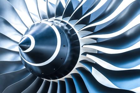 turbine engine: blue tone jet engine blades closeup