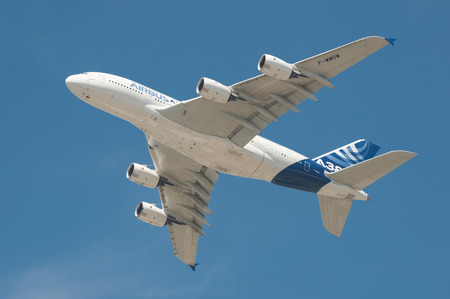 Farnborough, UK - July 18, 2014: Closeup of an Airbus A380 super-jumbo jet airliner in the skies above Farnborough, Hampshire, UK