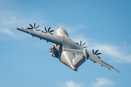 military aircraft: Farnborough, UK - July 18, 2014: Closeup of an Airbus A400M military transporter aircraft in a steep climb after take-off from Farnborough, Hampshire, UK Editorial