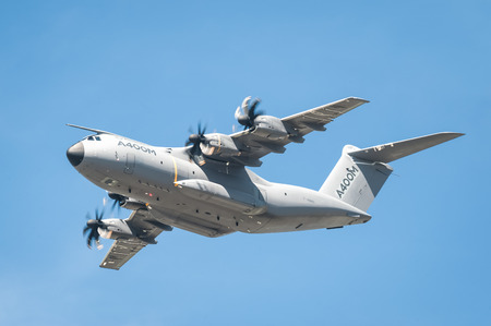military aircraft: Farnborough, UK - July 18, 2014: Closeup of an Airbus A400M military and emergency aid transporter aircraft in low-level flight over Farnborough, Hampshire, UK Editorial