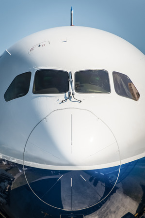 larger: nose cone closeup of a larger passenger jet airliner Stock Photo