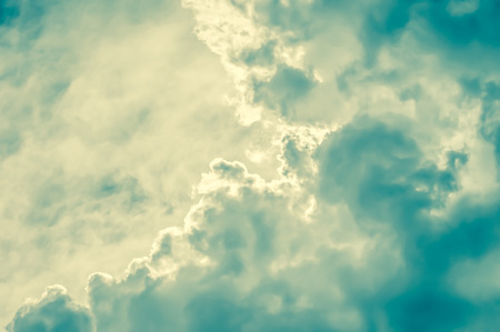 abstracts: retro toned cloudscape background with blue and yellow tint