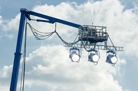 high powered: high powered spotlights illuminating an outdoor movie set Stock Photo