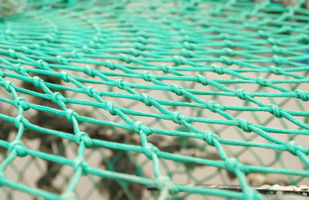 onboard: closeup of a fishing net onboard a trawler