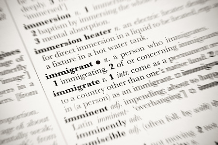 immigrant: dictionary definition of immigrant with blurred edges