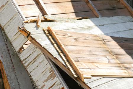 broken wood panels from a demolished shack