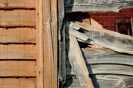 fence panel: new and old wooden fencing panels closeup