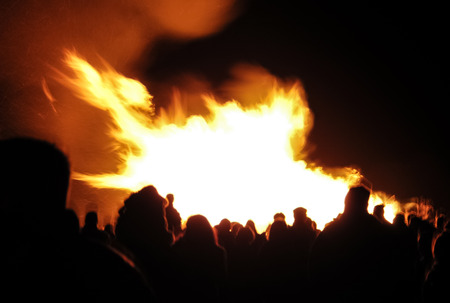 guy fawkes night: motion blur crowd of people around a bonfire Stock Photo