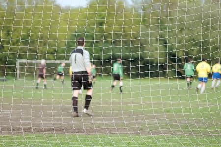 soccer net: soccer net and goal keeper teamwork concept Stock Photo