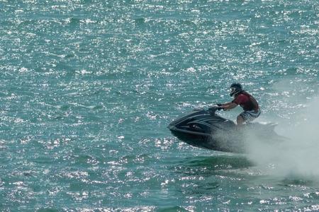 skimming: jet-ski rider skimming the waves at speed