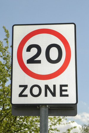 mph: UK road sign with a 20 mph zone limit Stock Photo