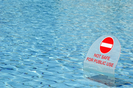 warning sign in a public swimming pool
