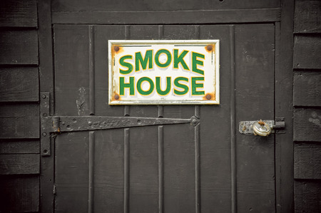 preperation: old fashioned food preperation smoke house sign and door