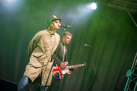 Yateley UK  July 2 2011: Paul Higginson performing as Liam Gallagher in rock tribute act Oasish in Yateley UK Editorial