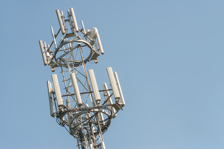 antenna: telephone and intenet communications tower against blue sky