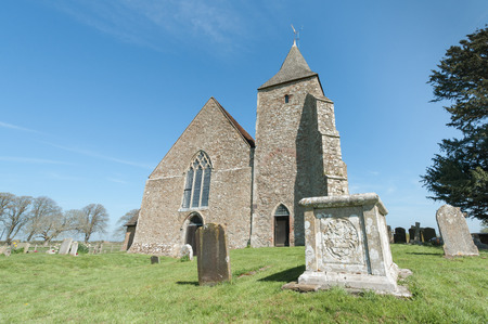 kent: 12th century stone church of St Clement in Old Romney Kent  UK Stock Photo