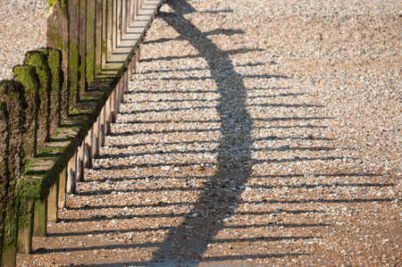 shingle beach: wavebreak shadows on a shingle beach