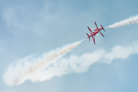 Farnborough UK  July 18 2014: Close pass by The Red Arrows formation aerobatic display team at an airshow over Farnborough UK