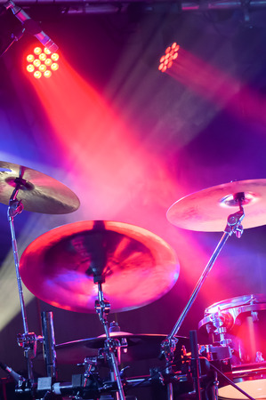cymbals: drum kit and cymbals under stage spotlights