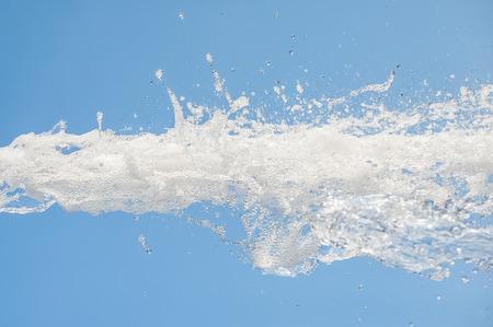 foaming water splash against a blue background
