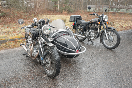 enfield: Rushmoor, UK - April 3, 2015: A rare vintage HRD motorcycle sidecar and a Royal Enfield at a wet Wheels Day motor festival in Rushmoor, UK Editorial