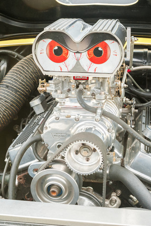 supercharger: Rushmoor, UK - April 3, 2015: Hot-rod engine bay with blood-shot carburetor intakes at the Wheels Day motor festival in Rushmoor, UK