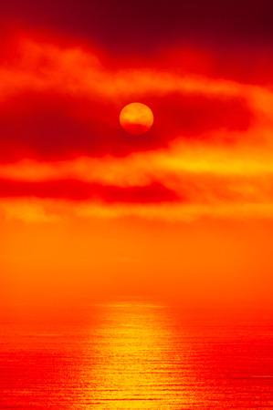 sunsets: red alien sunset over an ocean