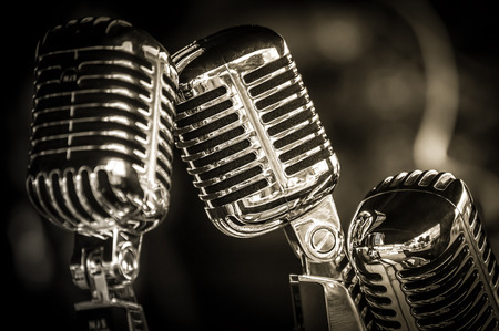 closeup of chromed retro recording studio microphones Foto de archivo