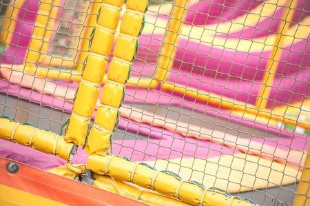 playground equipment: padded protection surrounding an adventure trampoline playground Stock Photo