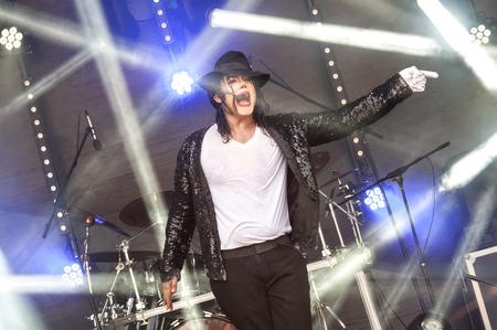 Yateley, UK - June 27, 2015: Navi, a professional Michael Jackson tribute artist and impersonator performing at the GOTG festival in Yateley, UK