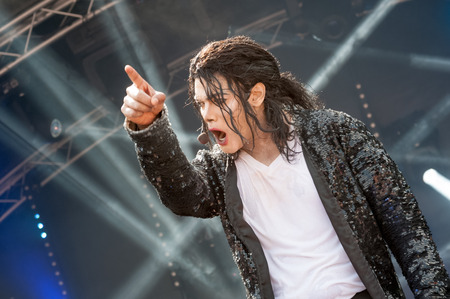 tribute: Yateley, UK - June 27, 2015: Navi, a professional Michael Jackson tribute artist and impersonator performing at the GOTG festival in Yateley, UK