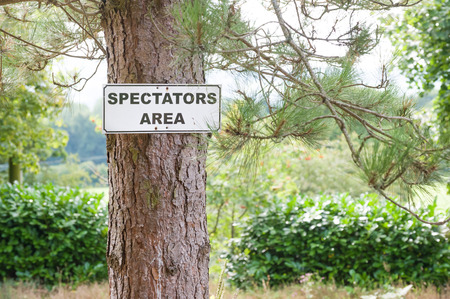 pin arbre: spectator viewing area sign on a pine tree