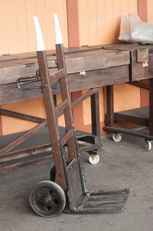 sacktruck: vintage wooden handcart on a railroad platform Stock Photo