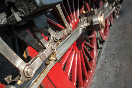coupling: wheels and coupling rods on a vintage locomotive - shallow d.o.f. Stock Photo